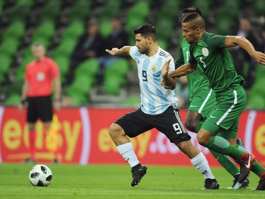 Argentina's Sergio Aguero, center, challenge for the ball with Nigeria's Leon Balogun, right, during the international friendly soccer match between Argentina and Nigeria in Krasnodar, Russia, Tuesday, Nov. 14, 2017. (AP Photo/Sergey Pivovarov)