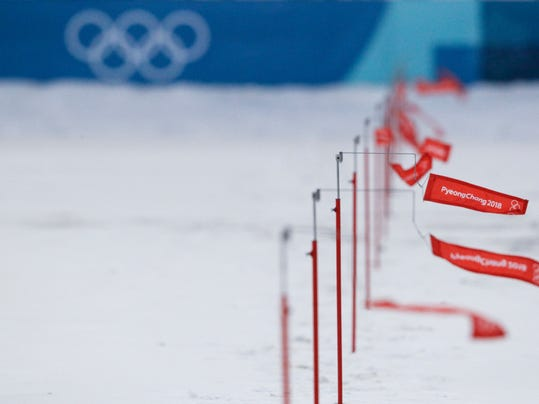 Flag wind speed indicator are waved by a breeze at he shooting range of the Alpensia Biathlon center as the women's 15km Individual race was canceled due to strong winds at the 2018 Winter Olympics in Pyeongchang, South Korea, Wednesday, Feb. 14, 2018. (AP Photo/Gregorio Borgia)