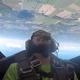 Enquirer reporter Nick Buckley flies in a loop over Battle Creek with the Phillips 66 Aerostars.