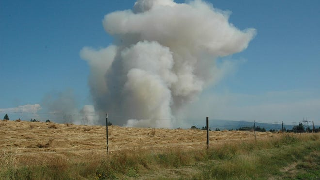 Field burning takes place at a grass seed field in the Lyons area in 2011. Field burning started Aug. 1 that year.