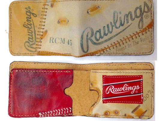 These wallets are made out of repurposed baseball gloves
