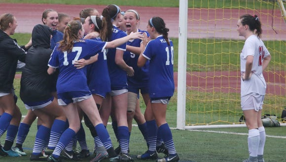 Pearl River players celebrate their overtime goal against