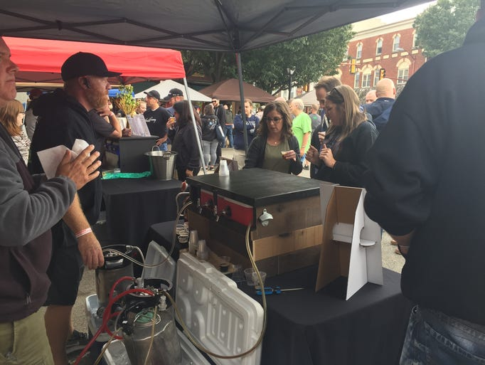Beer tasters sip different selections offered by homebrewers