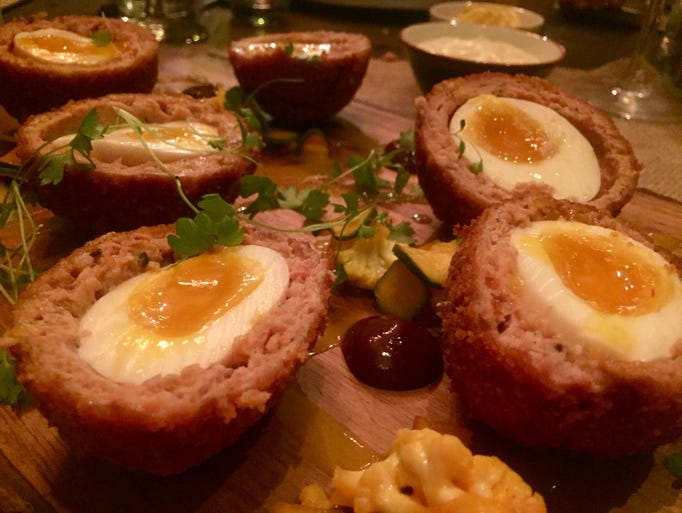 Scotch hen's egg with pheasant sausage.