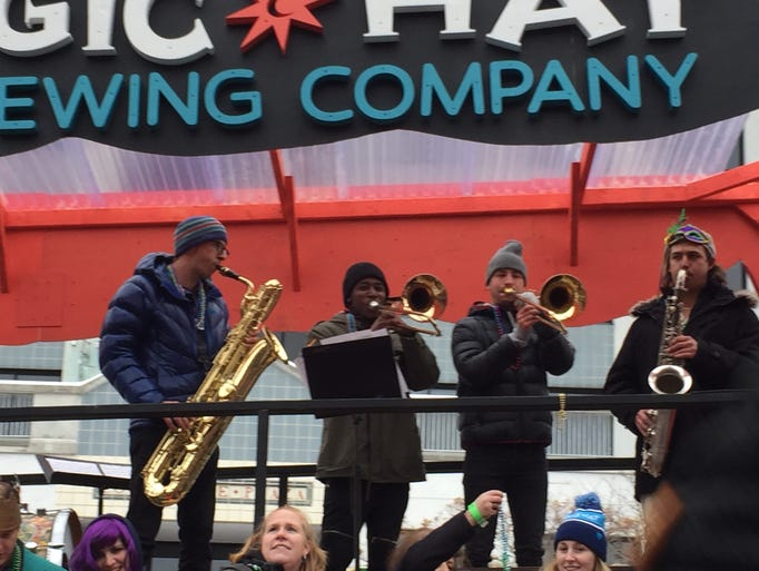 Musicians perform Saturday on the float presented by