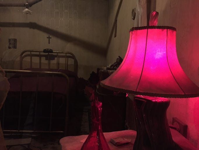 A red lamp serves as a reminder the Dumas Brothel Museum