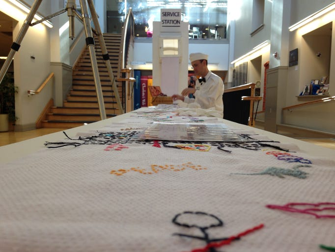 Photos traveling embroidery stops at martin library