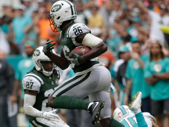 New York Jets free safety Marcus Maye (26) intercepts a pass intended for Miami Dolphins wide receiver Jarvis Landry (14), during the second half of an NFL football game, Sunday, Oct. 22, 2017, in Miami Gardens, Fla. (AP Photo/Lynne Sladky)
