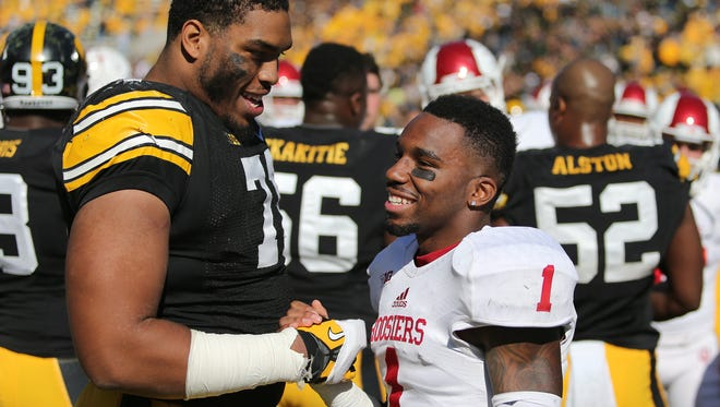Iowa left tackle Carl Davis, left, talks with Indiana wide receiver Shane Wynn following the Hawkeyes' win over the Hoosiers on Saturday, Oct. 11, 2014, at Kinnick Stadium in Iowa City, Iowa.
