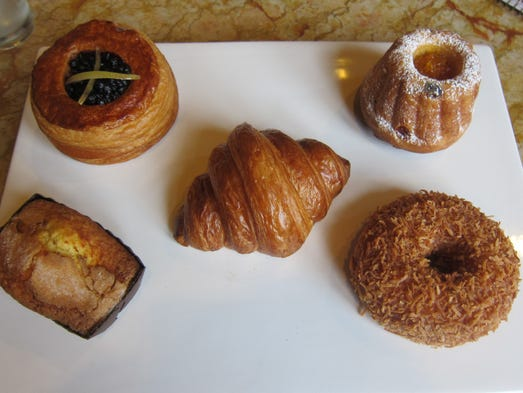 A sampling of the exceptional breakfast pastries at the CIA's Apple Pie Bakery Café, clockwise from upper left: blueberry Danish, kugel, caramel and coconut doughnut, pound cake and in center, croissant.