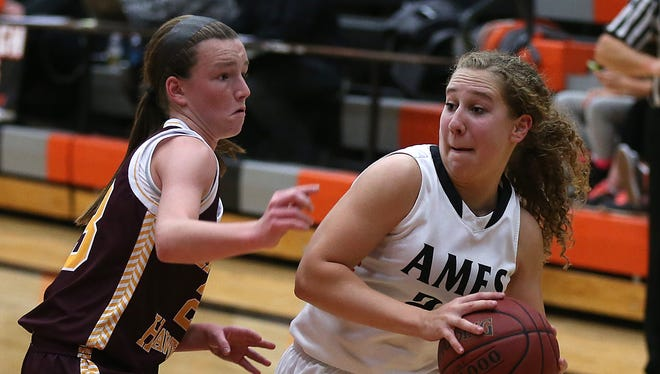 Ames' Molly Sanders, right, dribbles the ball against Ankeny's Kelsey Yarrow in a game from last season. Sanders has committed to play at the U.S. Naval Academy.