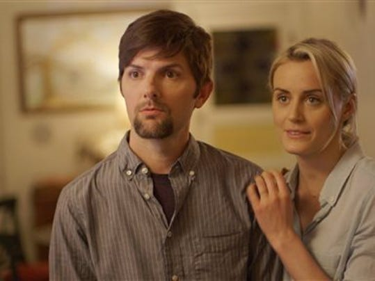"This photo provided by courtesy of The Orchard shows, Adam Scott, left, and Taylor Schilling, in a scene from the film, ""The Overnight."""