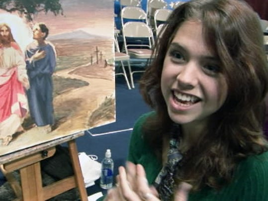Artist Adrienne Stein, of Springettsbury Township, talks about the art of liturgical painting at the conclusion of a worship service at York Alliance Church in this 2008 file photo.