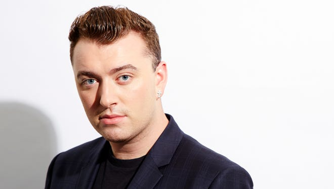 Sam Smith poses for a portrait, in New York on Sept. 17, 2014. Breakthrough newcomers Smith and 5 Seconds of Summer will take the stage at the 2014 American Music Awards.