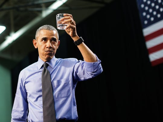 President Barack Obama takes a last drink of water