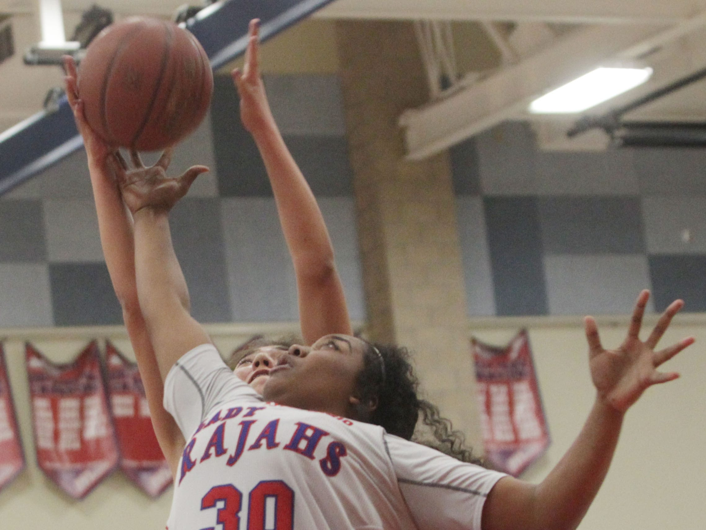 Indio High School's Jullissa Garza, in white, goes up for a rebound against Diamond Ranch High School during their CIF game at Indio. Indio won the game.