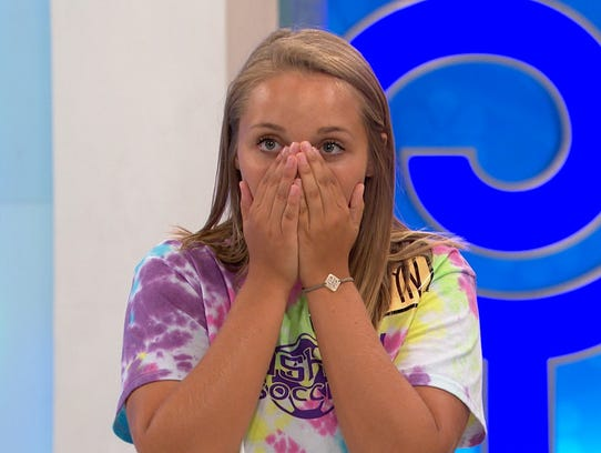 Londyn Feasel of Plainfield, Ind. reacts as she competes