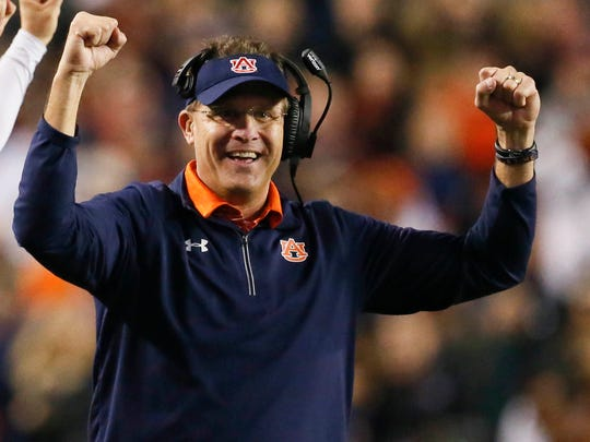 Gus Malzahn celebrates after his Tigers defeated No.
