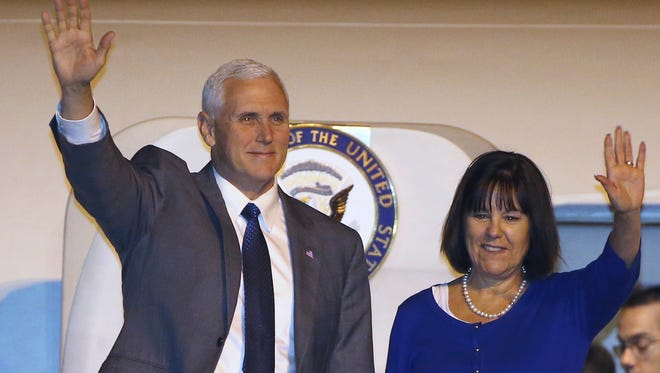 U.S. Vice President Mike Pence, left, and his wife Karen wave as they arrive in Sydney, Friday, April 21, 2017.