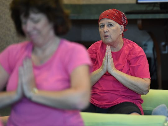 """""""It's the first time I've been here but it's been very relaxing,"""" said Sue Marcinko (right), of Stuart, during her workout at the Mindfulness Yoga for Cancer class Sept. 23, 2016, at Martin Health System's Robert & Carol Weissman Cancer Center in Stuart. """"It's a whole new experience,"""" said Marcinko, who is battling breast cancer."""