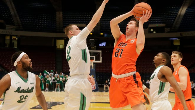 UTEP guard Trey Touchet penetrates the Marshal defense and attempts a shot over Marshall guard Stevie Browning during second half action in their 2016 Conference USA Men's Basketball Tournament last March, Marshal went on to win the game 87-85 ending UTEP's season.