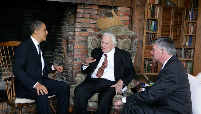 Billy Graham has counseled a dozen presidents over his career. Here he meets with former President Barack Obama at Graham's Montreat home. Franklin Graham, Billy's son, is at right.
