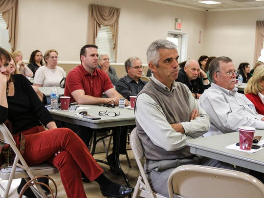 People listen during a workplace violence seminar presented by the Mount Olive Township Police Department at the Budd Lake Vol. Fire Company No.1 firehouse.