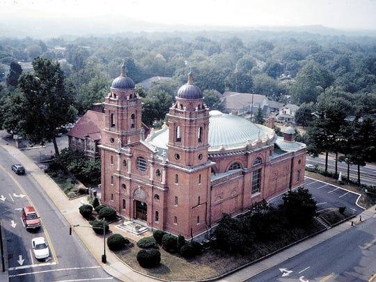 Local urban planners David Johnson and Tom Gallaher say Asheville has a grand opportunity to create a new public place on city-owned land across from the U.S. Cellular Center and the magnificent Basilica of St. Lawrence. (CITIZEN-TIMES PHOTO).