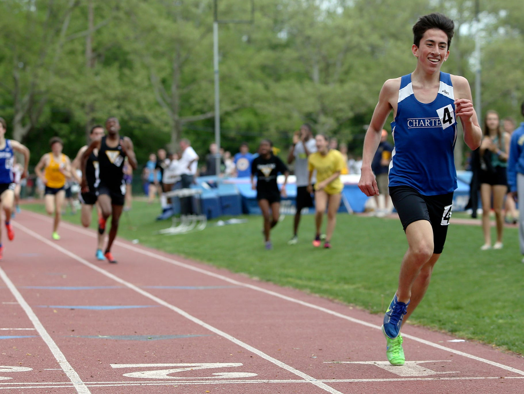 Charter School's Kieran Tuntivate, shown leaving the pack behind to win the 1600-meter run at the 2014 New Castle County Track and Field Championships at Baynard Stadium in Wilmington, won the event again this year.