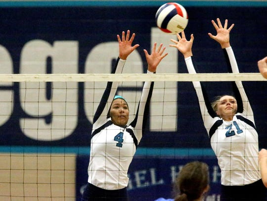 Siegel's Asha Phillips, left, and Leah Poarch defend