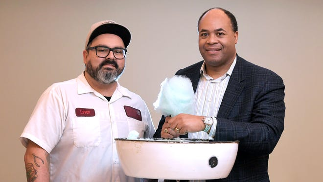 Gray & Dudley Executive Chef Levon Wallace, left, and historian David Ewing stand together with an antique Electric Candy Floss Machine at Gray & Dudley restaurant inside Nashville's 21c Museum Hotel where it's a hotel tradition to serve cotton candy after every meal.