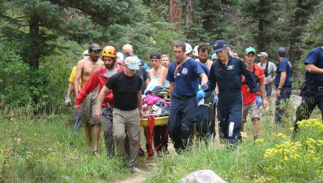 First responders and fellow climbers rescue Thad Ferrell after his 100-foot fall near Durango, Colorado.