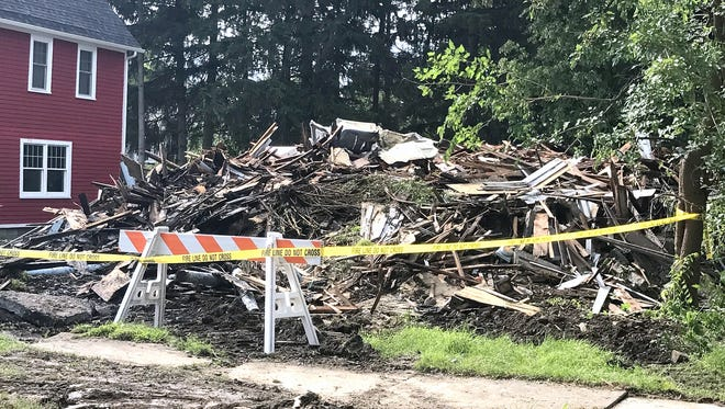 A vacant house on West Gray Street in Elmira that was heavily damaged by fire was torn down Thursday evening.