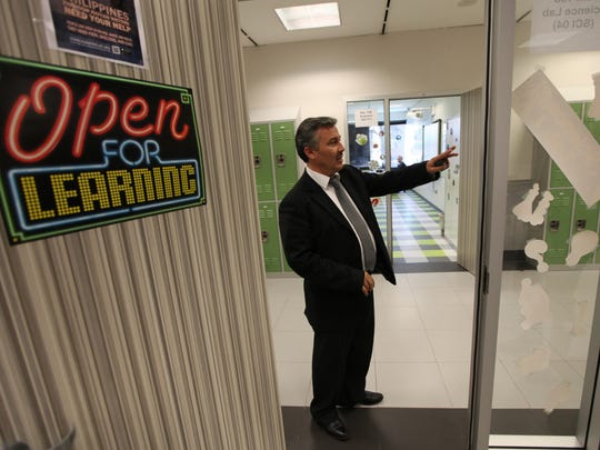 Former principal Sukan Alkin gives a tour of the location for Pioneer Academy in Wayne in this November 2013 file photo.
