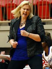 Hillcrest coach Jeni Hopkins celebrates during Hillcrest's