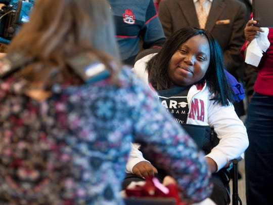 Marquisha Jones, who was paralyzed by a stray bullet, is presented items to help her with her dream of going to law school on Friday February 10, 2017 at Carver High School in Montgomery, Ala. The event was organized by Magic Moments and Hill Hill Carter law firm.