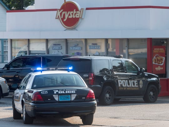 Police work the scene near the Krystal on Norman Bridge Road Montgomery, Ala., on Tuesday September 5, 2017.