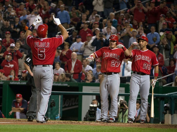 Los Angeles Angels' Albert Pujols became the 26th player to hit 500 career home runs. A look back at his career highlights: April 22 --Pujols celebrates with teammates at home plate after hitting his 500th career home run at Nationals Park.