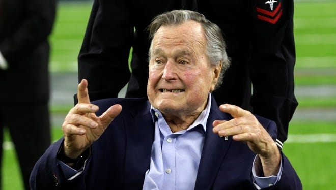 In this Feb. 5, 2017, file photo, former President George H.W. Bush arrives on the field for a coin toss before the NFL Super Bowl 51 football game between the Atlanta Falcons and the New England Patriots in Houston.