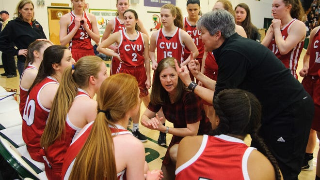 CVU head coach Ute Otley talks to the team during a time out in the Vermont high school girls division I basketball championship between the St. Johnsbury Hilltoppers and the Champlain Valley Union Redhawks at Patrick Gym on Sunday afternoon March 11, 2018 in Burlington.