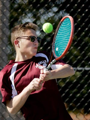 La Salle's Mike Stabile backhands the ball to a Barrington opponent during a match in April 2019. The greatest effect the pandemic has had on Stabile has been the disruption of his daily routine, he says.
