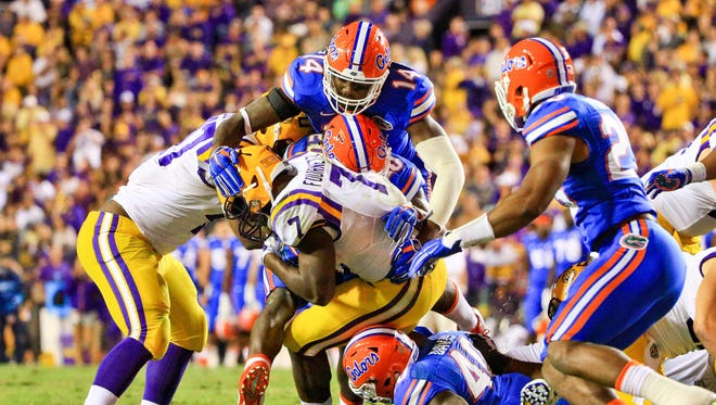 LSU running back Leonard Fournette is tackled by Florida defenders during their game in 2015.