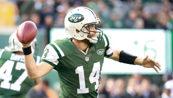 Ryan Fitzpatrick #14 of the New York Jets throws a pass against the Baltimore Ravens at MetLife Stadium on October 23, 2016 in East Rutherford, New Jersey.