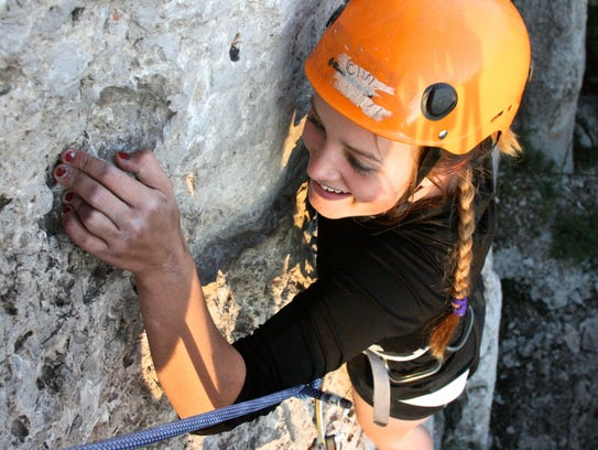 Student Mary Liebert climbs a mountain as part of an