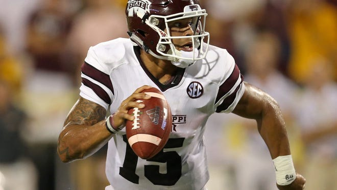 Sep 5, 2015; Hattiesburg, MS, USA; Mississippi State Bulldogs quarterback Dak Prescott (15) looks to throw in the second half of their game against the Southern Miss Golden Eagles at M.M. Roberts Stadium. Mississippi State won, 34-16. Mandatory Credit: Chuck Cook-USA TODAY Sports