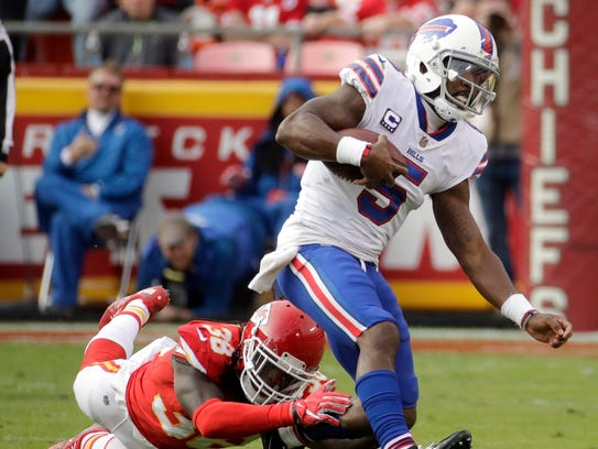 Buffalo Bills quarterback Tyrod Taylor (5) is tackled