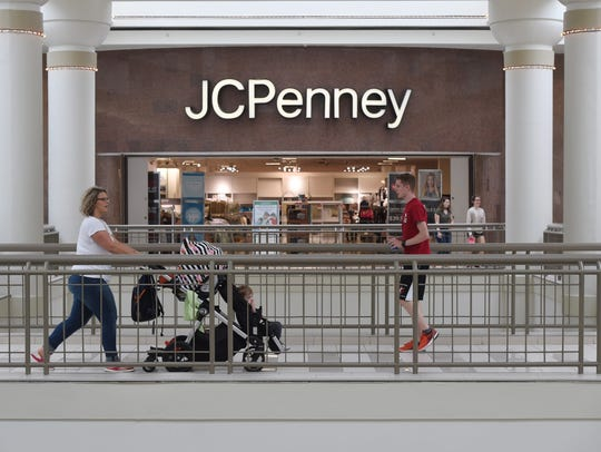 Shoppers travel in front of JCPenney at the Poughkeepsie
