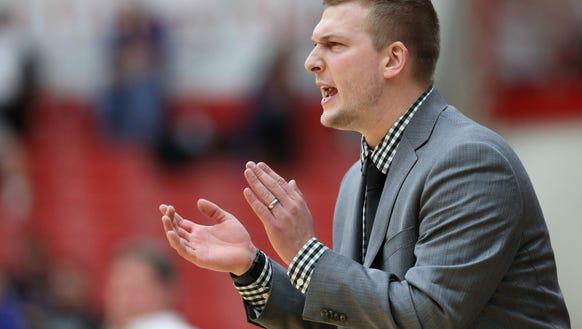 Center Grove head coach Zach Hahn encourages his team