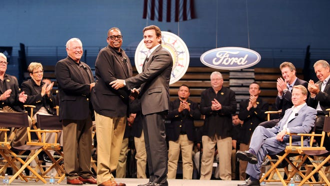 Ford and UAW marks the official start of contract talks with official handshakes including UAW Vice President Jimmy Settles, center left,  shaking Chief Executive Officer of Ford Mark Fields' hand as UAW President Dennis Williams looks on, left and Executive Chairman of Ford Bill Ford Jr.  looks on from his seat at Cass Technical High School in Detroit on Thursday, July 23, 2015. Regina H. Boone/Detroit Free Press