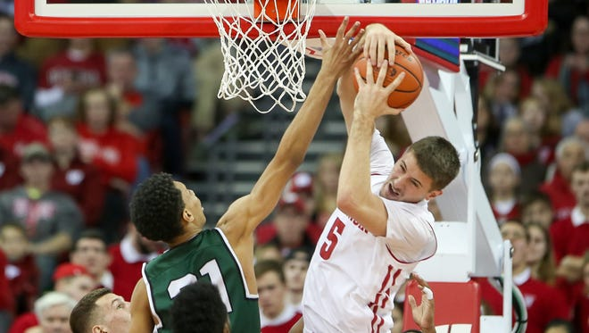 Wisconsin forward Aaron Moesch  fights for a rebound with Chicago State forward Cameron Bowles  on Wednesday night at the Kohl Center.